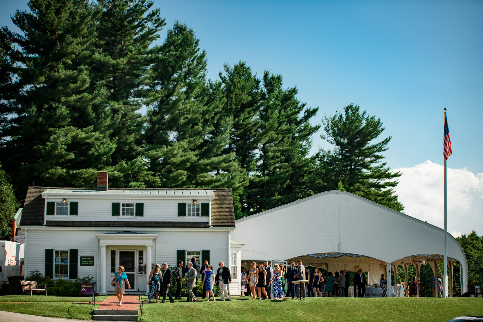 backdrop to fruitlands museum tent and building