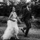 bride and groom runnig